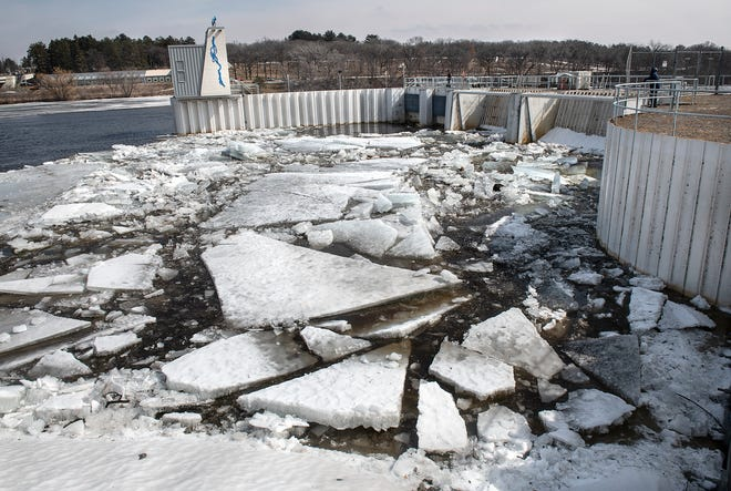 Large chunks of ice are jammed up at the St. Cloud Dam on the Mississippi River Wednesday, March 27, 2019, as large amounts of water flow downstream.