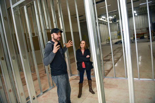 Jay and Tina Mrozek talk about features at BlackLight Adventures, under construction Tuesday, March 26, at 240-33rd Ave. S in St. Cloud.