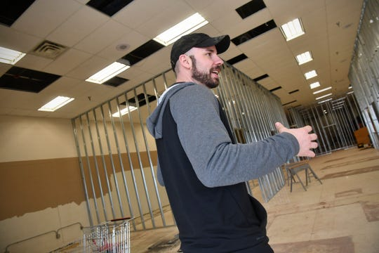 Jay Mrozek talks about plans for BlackLight Adventures, under construction Tuesday, March 26, in St. Cloud.