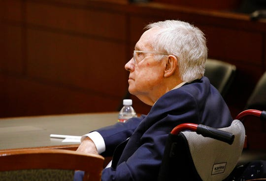 Former U.S. Sen. Harry Reid sits in court Tuesday, March 26, 2019, in Las Vegas. A jury in Nevada heard opening arguments Tuesday in Reid's lawsuit against the maker of a flexible exercise band that he says slipped from his hand while he used it in January 2015, causing him to fall and suffer lasting injuries including blindness in one eye. (AP Photo/John Locher)