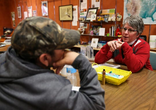 The Rev. Jane Johnson talks with a community member on Tuesday, March 26, 2019, at Franciscans Downtown in Stevens Point, Wis. Johnson heads Extending the Table, a local outreach ministry for the homeless, LGBT and youth communities.