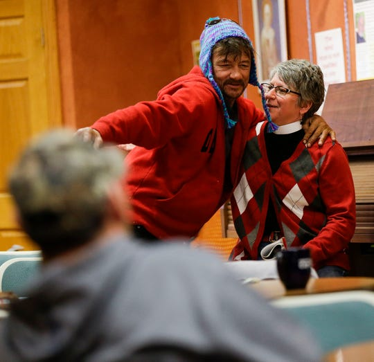 Frank Legner hugs the Rev. Jane Johnson on Tuesday, March 26, 2019, at Franciscans Downtown in Stevens Point, Wis. Johnson heads Extending the Table, a local outreach ministry for the homeless, LGBT and youth communities. Tork Mason/USA TODAY NETWORK-Wisconsin