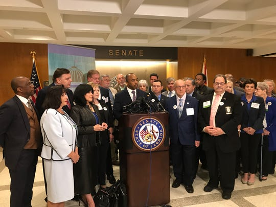Sen. Bobby Powell, D-Palm Beach, and the Florida League of Mayors protest state lawmakers' attempts to preempt local regulations to the state