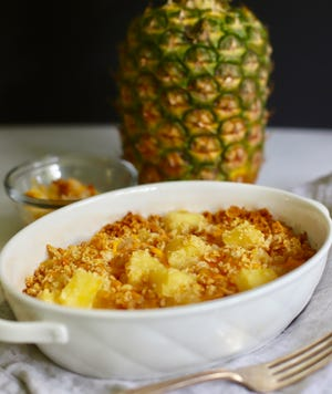 Southern Pineapple Casserole combines cheese and Ritz crackers.