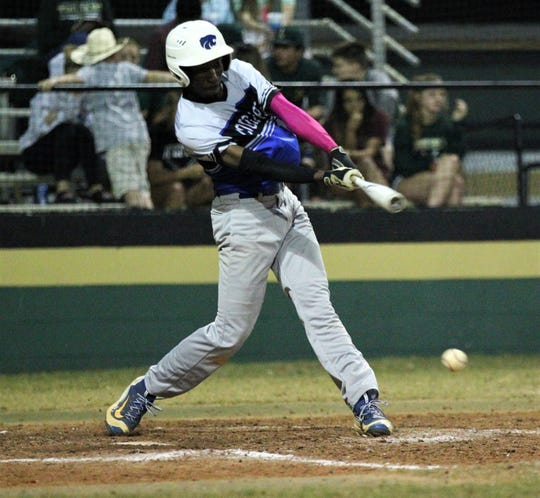 Godby's Rashard Cohen bats as Lincoln beat Godby 21-0 on Tuesday, March 26, 2019.