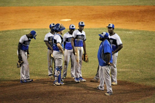 Godby baseball coach Tonayne Brown makes a pitching change as Lincoln beat Godby 21-0 on Tuesday, March 26, 2019.