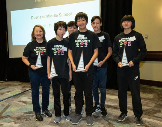 The second-place MATHCOUNTS team from Deerlake Middle School. Left to right: Coach Terry King, Aaron Hu (7th), Bruce Yang (8th), Wesley Chen (8th), Cyrus Nadizadeh (8th), Alternate Lillian Zhang (6th)