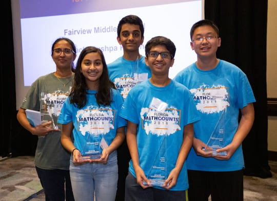 The first-place MATHCOUNTS team from Fairview Middle School. Left to right: Coach Pushpa Kurian, Ananya Mundrathi (8th), Karthik Vedula (8th), Tanmay Haldiya (8th), Eric Zeng (8th)