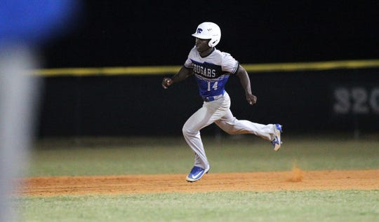 Godby's Javin Davis heads to second on a double as Lincoln beat Godby 21-0 on Tuesday, March 26, 2019.