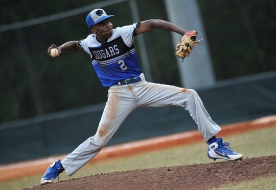 Godby's Tim Brown pitches as Lincoln beat Godby 21-0 on Tuesday, March 26, 2019.