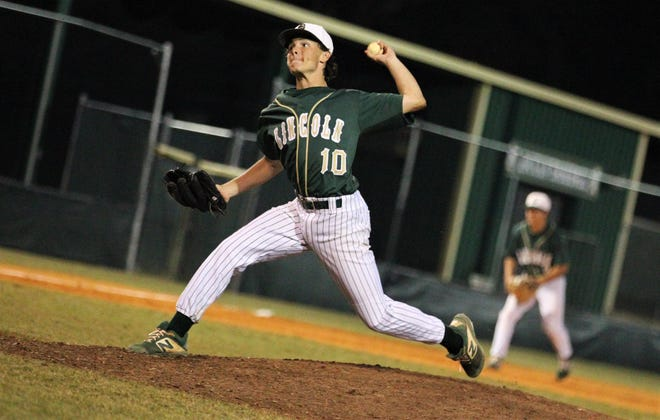 Lincoln senior Shawn Snyder pitches as the Trojans beat Godby 21-0 on Tuesday, March 26, 2019.