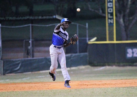 Godby shortstop Micha Mitchell throws to first base as Lincoln beat Godby 21-0 on Tuesday, March 26, 2019.