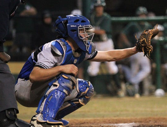 Godby catcher Seth Sapp readies for a pitch as Lincoln beat Godby 21-0 on Tuesday, March 26, 2019.