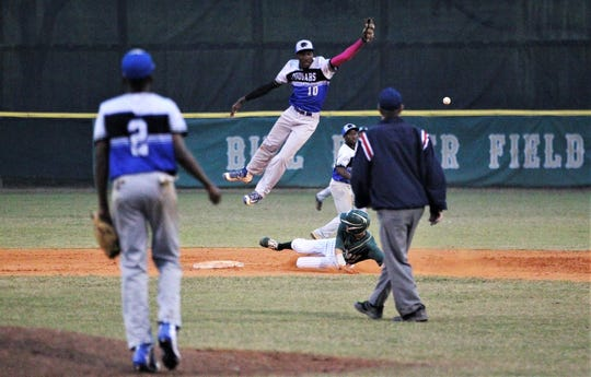 Godby second baseman Rashard Cohen can't grab a pick-off throw as Lincoln beat Godby 21-0 on Tuesday, March 26, 2019.