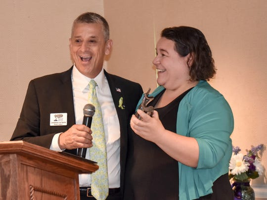 Indian River County Commissioner Joe Flescher, left, is surprised to receive the Community Builder Award from Keep Indian River Beautiful Executive Director Daisy Packer.