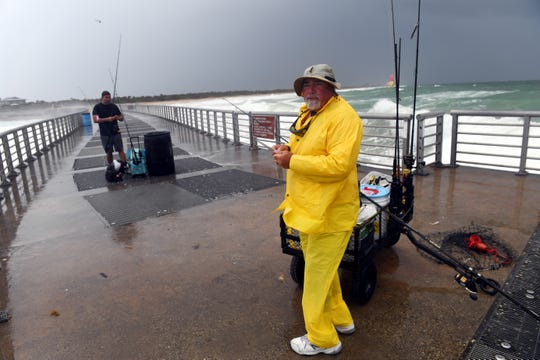 John Lavorgna, of Danbury, New Hampshire, braves the wind and the ocean spray on Wednesday, March 27, 2019, while fishing at the end of the pier at Sebastian Inlet State Park in north Indian River County. More cooler, rainy days are expected on the Treasure and Space coasts.