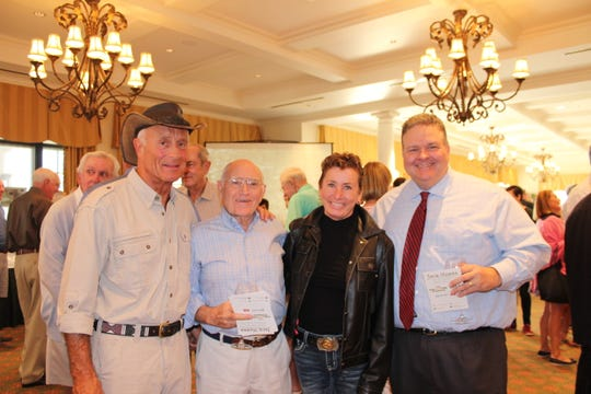 America's favorite zookeeper Jack Hanna, left, Jim Casto, Shay Griese, and Tim O'Neill attend a neighborhood cocktail party for Busch Wildlife Sanctuary at Jupiter Hills Country Club.
