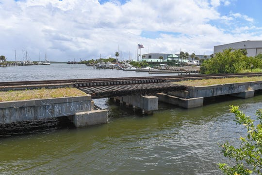 The Florida East Coast railway bridge at Taylor Creek is seen on Wednesday, March 27, 2019, which is located next to a closed section of Old Dixie Highway at Taylor Creek in Fort Pierce. According to a police report, Clarence Taylor, 47 and his fiancée Karen Nicholson, 54, were fishing from the FEC bridge Tuesday evening when a north-bound train approached. Nicholson jumped into the water to escape from the oncoming train, while Taylor, her fiancé was struck and pronounced dead on the scene.  CQ: Karen Nicholson, Clarence Taylor