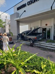 Truck driver crashed into building in Stuart Wednesday afternoon.