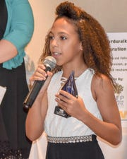 Nine-year-old McKenzie Williams tells everyone to give back to the environment after receiving her 2018 Environmental Young Hero Award.