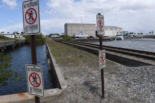 The Florida East Coast railway bridge at Taylor Creek is seen on Wednesday, March 27, 2019, which is located next to a closed section of Old Dixie Highway at Taylor Creek in Fort Pierce. According to a police report, Clarence Taylor, 47, and his fiancée Karen Nicholson, 54, were fishing from the FEC bridge Tuesday evening when a northbound train approached. Nicholson jumped into the water to avoid being struck by the oncoming train, while Taylor was struck and pronounced dead on the scene.