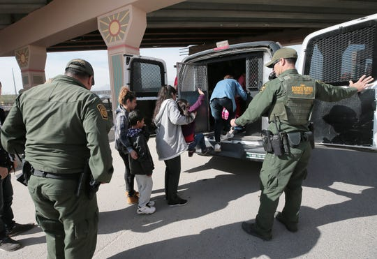 A group of migrants were detained shortly before U.S. Customs and Border Protection Commissioner Kevin K. McAleenan held a news conference in the Chihuahuita neighborhood of El Paso on Wednesday, March 27, 2019.