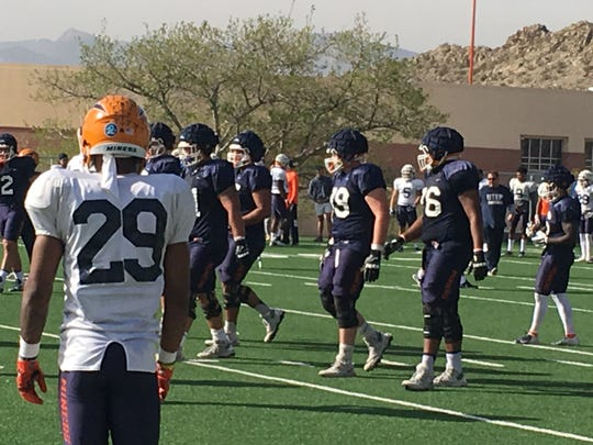 Elijah Klein (79) and other UTEP offensive linemen ready for a play Wednesday at Glory Field
