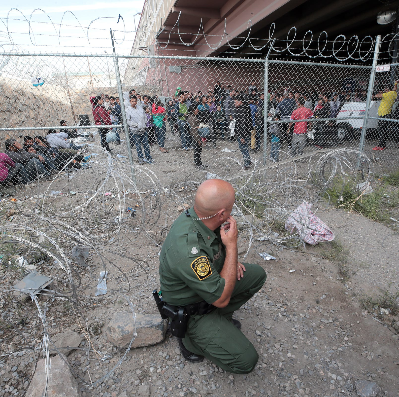 Davis: What kind of nation allows people to be penned in a cage surrounded by barbed wire?