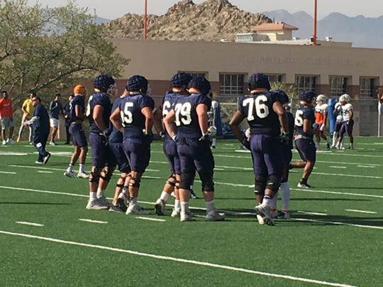 The UTEP offensive line, including Elijah Klein (79) and Ruben Guerra (center, 61) prepare for a play Wednesday at Glory Field