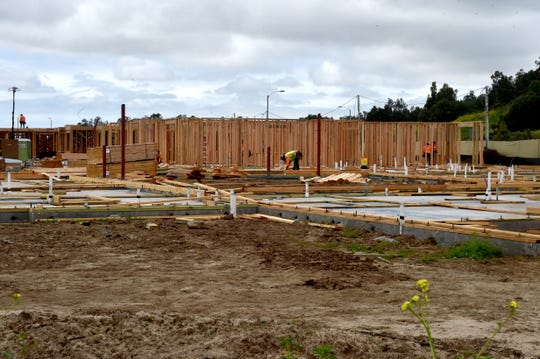 New residential buildings take shape at a development in Camarillo near Ponderosa Drive on Wednesday.
