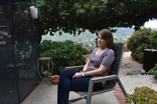 Teresa Valko watches the aviary outside her home near Camarillo. She has a family history of Alzheimer's and a test confirmed she's at higher risk of acquiring the disease.