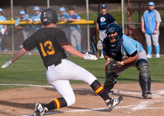 Monache catcher Troy Nieto prepares to out Tulare Union's Nick Hogg at  home in an East Yosemite League high school baseball game on Tuesday, March 26, 2019.