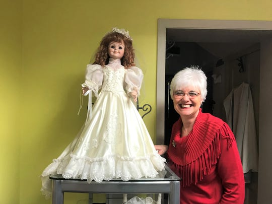 Owner Jill Nezworski bought this doll in a bridal gown from the family who owned the first bridal shop she worked at, when she was just 14 years old. After that owner, a family friend who made dolls, passed away, Nezworski said she wanted the doll in the shop as a new beginning. The doll is named Carolyn after the former owner.