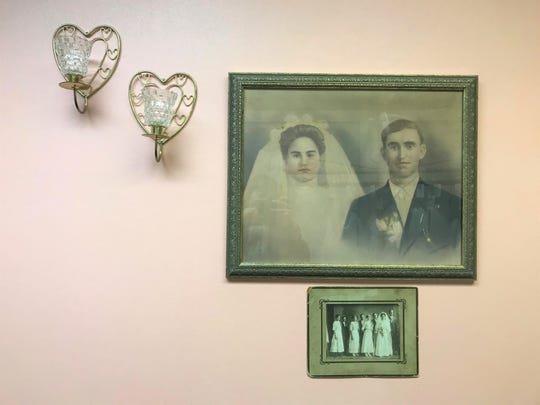 There are five generations of family wedding photos on the walls at With This Ring bridal shop.