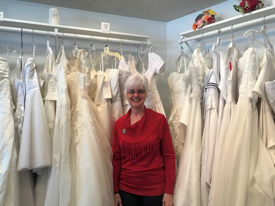 Owner Jill Nezworski prepares to close With This Ring bridal shop after a decade in business. Her favorite part of the job has been making friends with strangers and putting people at ease while they shop for their big days.