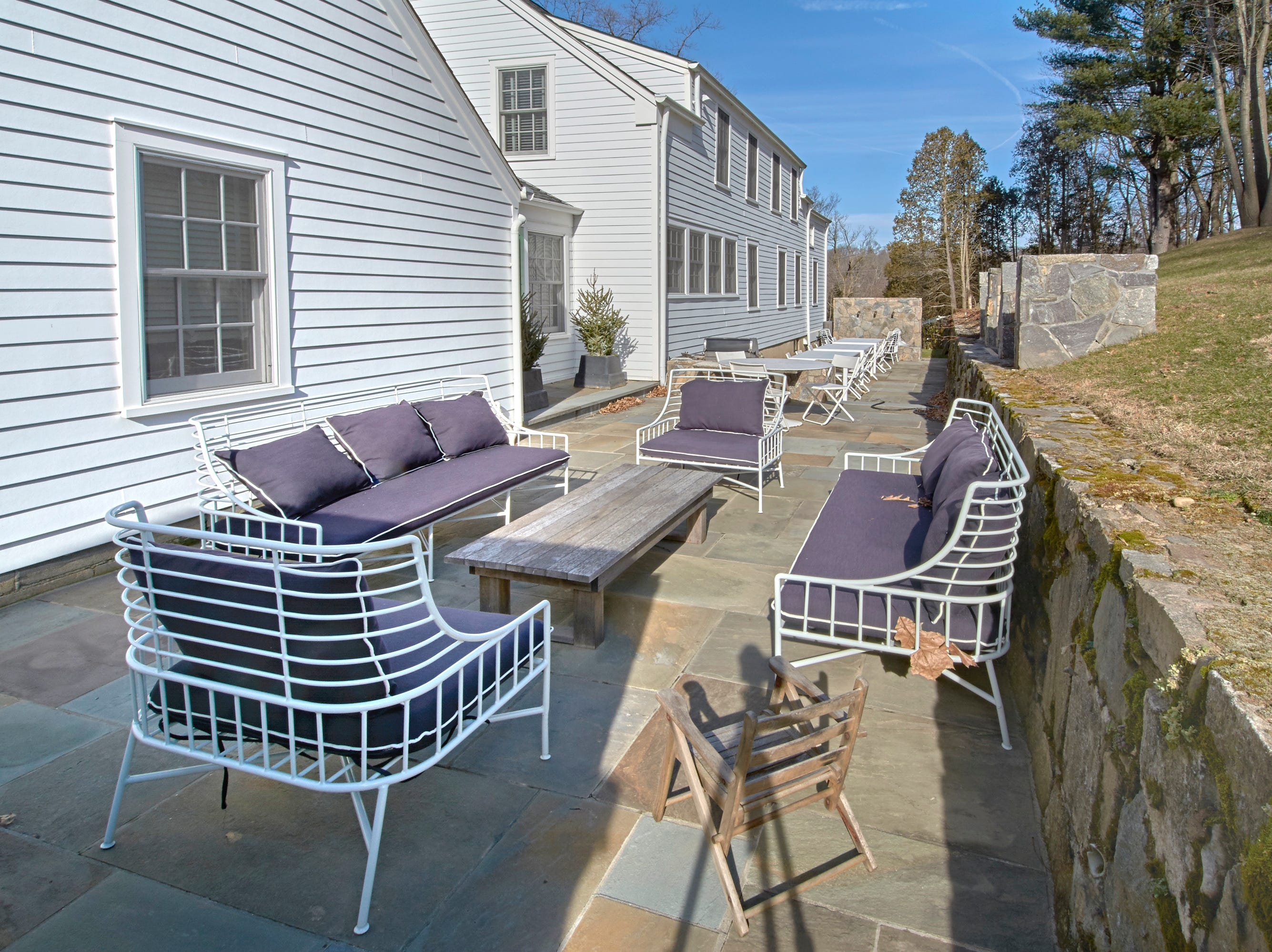 The homeowners added this private and expansive terrace which includes a water feature at the far end.