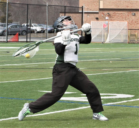 Brewster goalie Danielle Heintz prepares to fling the ball downfield during a game vs. Lakeland/Panas.