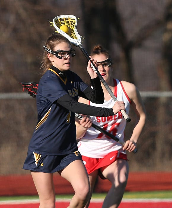 Pelham's Claudia Dodge (1) fires a shot in front of Somers' Jen Campbell (16)  during girls lacrosse action at Somers High School March 26, 2019. Pelham won the game 14-10.