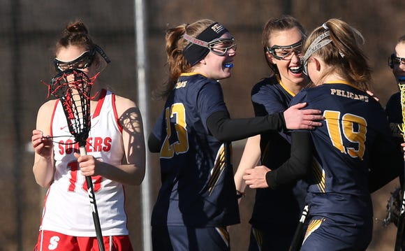 Pelham's Sidney Skop (19) celebrates a goal against Somers with teammates during girls lacrosse action at Somers High School March 26, 2019. Pelham won the game 14-10.