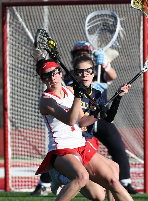 Somers' Emma Kittredge (1) tries to get around Pelham's Claudia Dodge (1)  during girls lacrosse action at Somers High School March 26, 2019. Pelham won the game 14-10.