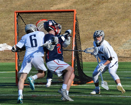 Stepinac midfielder Kevin McKenna gets ready to unleash a shot through a scrambling defense during a 15-3 win at Kennedy Catholic on March 26, 2019.