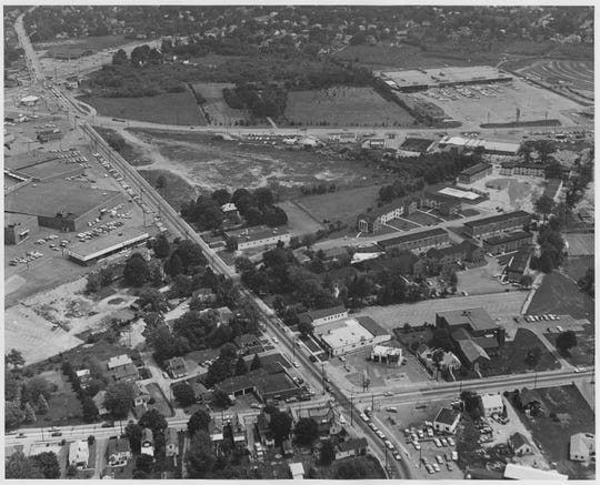 Old Capitol Trail near Prices Corner in 1965. Newport Gap Pike intersects at the bottom of the photo, while the Prices Corner Shopping Center can be seen on the center left. The old Gaylords Department Store (now Walmart) is on the upper right.