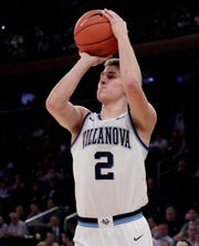 Villanova guard Collin Gillespie shoots against Xavier during the first half of an NCAA college basketball semifinal game in the Big East men's tournament, Friday, March 15, 2019, in New York.