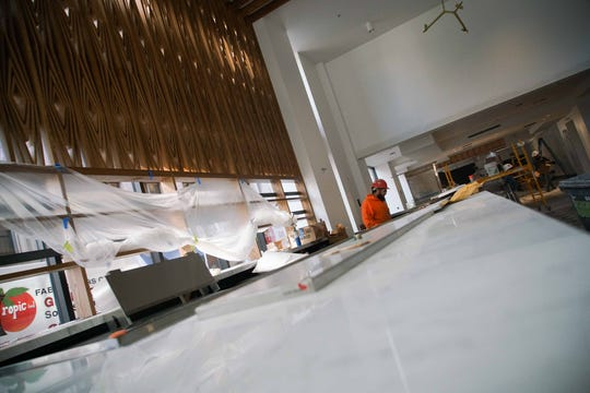 Workers continue construction of DECO, the new downtown Wilmington food hall on the first floor of the DuPont Building is in the homestretch of completion for an April 18th opening.