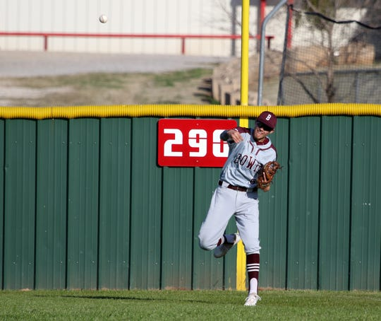 Bowie's Payton Price throws the ball to the cutoff in the game against Holliday Tuesday, March 26, 2019, in Holliday.