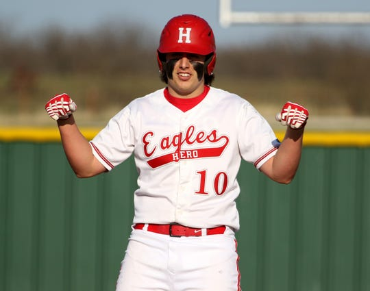 Holliday's Blake Lindemann celebrates his 2-RBI double against Bowie Tuesday, March 26, 2019, in Holliday.