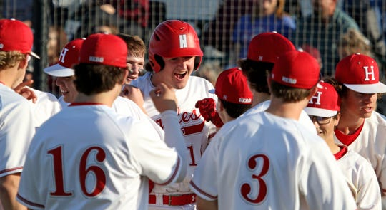 Holliday's Logan Whitling celebrates his two run homerun against Bowie Tuesday, March 26, 2019, in Holliday.