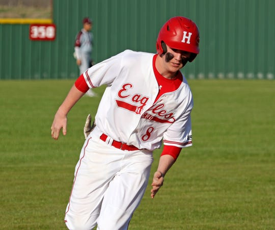 Holliday's Chris Jackson rounds third in the game against Bowie Tuesday, March 26, 2019, in Holliday.