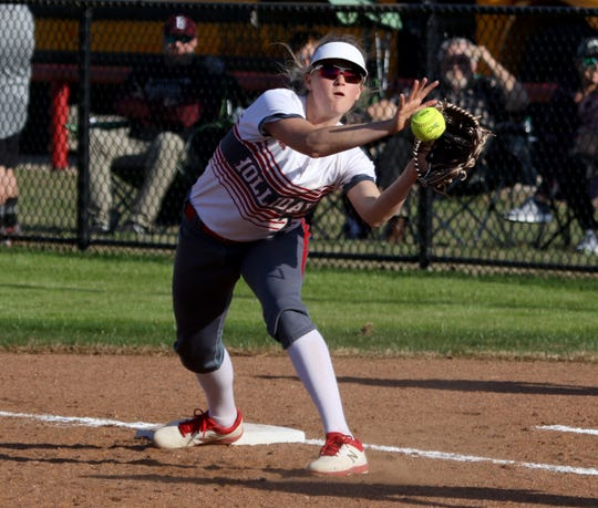Holliday's Ambri Harrigal catches the ball for the out against Bowie Tuesday.
