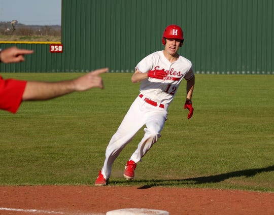 Holliday's Connor Cox runs home to score against Bowie Tuesday, March 26, 2019, in Holliday.